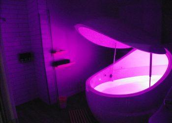 Float tank illuminated inside a float pod room